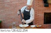 Купить «Chef mix ingredients for dough, puttung salt and pepper», видеоролик № 28622254, снято 14 апреля 2017 г. (c) Vasily Alexandrovich Gronskiy / Фотобанк Лори