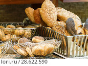 Купить «bread of different varieties in bakery», фото № 28622590, снято 21 июня 2014 г. (c) Володина Ольга / Фотобанк Лори