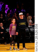 Купить «Celebrities at the Los Angeles Lakers game. The Golden State Warriors defeated the Los Angeles Lakers by the final score of 109-85 at the Staples Center...», фото № 28626058, снято 25 ноября 2016 г. (c) age Fotostock / Фотобанк Лори