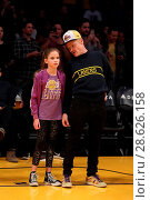 Купить «Celebrities at the Los Angeles Lakers game. The Golden State Warriors defeated the Los Angeles Lakers by the final score of 109-85 at the Staples Center...», фото № 28626158, снято 25 ноября 2016 г. (c) age Fotostock / Фотобанк Лори
