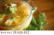 Купить «Chicken soup with homemade noodles», видеоролик № 28626822, снято 23 июня 2018 г. (c) Peredniankina / Фотобанк Лори