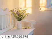 Купить «wild flowers in jug on white wooden bench», фото № 28626878, снято 20 июня 2018 г. (c) Майя Крученкова / Фотобанк Лори
