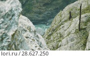 Купить «Canyon on the alpine path of the Manaslu circuit trek», видеоролик № 28627250, снято 17 июня 2018 г. (c) Dzmitry Astapkovich / Фотобанк Лори