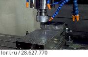 Купить «Precision milling CNC machine tool makes part», видеоролик № 28627770, снято 28 мая 2018 г. (c) Андрей Радченко / Фотобанк Лори