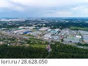 Купить «Aerial view of wheat fields, meadow, forest andindustrial warehouses in rural Russia.», фото № 28628050, снято 11 июня 2018 г. (c) Андрей Радченко / Фотобанк Лори