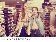 Купить «Mother and teen girl holding supplies for painting in hands», фото № 28628178, снято 12 апреля 2017 г. (c) Яков Филимонов / Фотобанк Лори