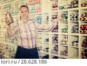 Купить «Woman customer holding spray with color paint», фото № 28628186, снято 12 апреля 2017 г. (c) Яков Филимонов / Фотобанк Лори
