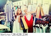 Купить «two girls with shopping bags in shop», фото № 28628234, снято 20 сентября 2018 г. (c) Яков Филимонов / Фотобанк Лори
