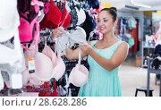 Купить «Girl selecting underwear», фото № 28628286, снято 19 июня 2017 г. (c) Яков Филимонов / Фотобанк Лори
