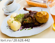 Купить «Baked duck with blue cabbage and yeast dumplings», фото № 28628442, снято 11 мая 2018 г. (c) Яков Филимонов / Фотобанк Лори