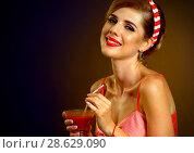 Купить «Retro woman with music vinyl record. Pin up girl drink martini cocktail.», фото № 28629090, снято 21 сентября 2018 г. (c) Gennadiy Poznyakov / Фотобанк Лори