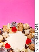 Купить «Большой праздничный торт на розовом фоне, вид сверху», фото № 28629326, снято 21 июня 2018 г. (c) V.Ivantsov / Фотобанк Лори