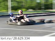 Купить «Kart racing. Tandem», фото № 28629334, снято 24 июня 2018 г. (c) Евгений Ткачёв / Фотобанк Лори