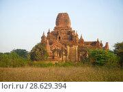 Купить «Древний буддистский храм ранним утром. Баган, Мьянма (Бирма)», фото № 28629394, снято 23 декабря 2016 г. (c) Виктор Карасев / Фотобанк Лори