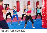 Купить «women are boxing and doing kick with coach», фото № 28629822, снято 8 октября 2017 г. (c) Яков Филимонов / Фотобанк Лори