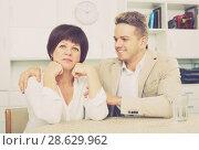 Купить «Mother and son sit at table», фото № 28629962, снято 15 октября 2018 г. (c) Яков Филимонов / Фотобанк Лори