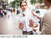 Купить «Angry woman getting rid of unwelcome stranger», фото № 28630018, снято 20 марта 2019 г. (c) Яков Филимонов / Фотобанк Лори