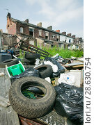 Купить «Illegal fly tipping in a rundown area of Blackburn, England, UK. June 2006», фото № 28630754, снято 22 сентября 2018 г. (c) Nature Picture Library / Фотобанк Лори