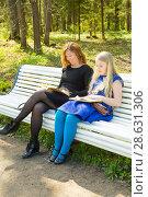 Купить «Blonde girl and her mother sitting on a bench in a park and reading books», фото № 28631306, снято 21 мая 2017 г. (c) Сергей Дубров / Фотобанк Лори