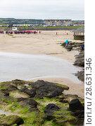 Купить «General view at Portrush beach and houses in the distance», фото № 28631346, снято 1 июля 2017 г. (c) Ольга Марк / Фотобанк Лори