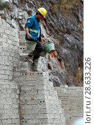 Купить «Worker on construction site.», фото № 28633226, снято 17 февраля 2019 г. (c) age Fotostock / Фотобанк Лори