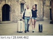 Купить «Charming man and woman going the historic city center», фото № 28644462, снято 25 мая 2017 г. (c) Яков Филимонов / Фотобанк Лори