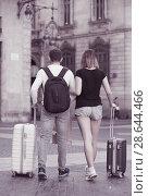 Купить «Young man and woman walking with baggage», фото № 28644466, снято 25 мая 2017 г. (c) Яков Филимонов / Фотобанк Лори