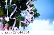 Купить «Christmas tree decorated with balls», видеоролик № 28644754, снято 26 июня 2018 г. (c) Peredniankina / Фотобанк Лори
