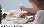 Купить «Mom and child puts the sugar and mixing the dough for pancakes», фото № 28645074, снято 19 июля 2018 г. (c) Константин Шишкин / Фотобанк Лори