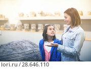 Купить «Glad mother and daughter looking at bas-reliefs», фото № 28646110, снято 20 июля 2018 г. (c) Яков Филимонов / Фотобанк Лори