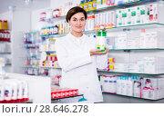Купить «Glad female pharmacist offering products», фото № 28646278, снято 31 января 2017 г. (c) Яков Филимонов / Фотобанк Лори