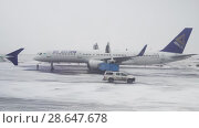 Купить «Treatment of the aircraft from icing before the flight in Astana International Airport stock footage video», видеоролик № 28647678, снято 30 марта 2018 г. (c) Юлия Машкова / Фотобанк Лори