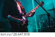 Купить «Solo on electric guitar in cyan lights», фото № 28647818, снято 11 декабря 2016 г. (c) EugeneSergeev / Фотобанк Лори