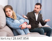 Купить «Father and daughter arguing», фото № 28647854, снято 4 марта 2017 г. (c) Яков Филимонов / Фотобанк Лори