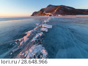Купить «Lake Baikal in winter day. Cracks on the smooth surface of the ice near the cliffs of Olkhon Island», фото № 28648966, снято 16 июля 2018 г. (c) Владимир Пойлов / Фотобанк Лори