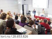 Купить «Business speaker giving a talk at business conference event.», фото № 28653826, снято 11 декабря 2014 г. (c) Matej Kastelic / Фотобанк Лори