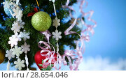 Купить «Christmas tree decorated with balls», видеоролик № 28654046, снято 26 июня 2018 г. (c) Peredniankina / Фотобанк Лори