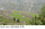 Купить «High-mountainous village Prok in Nepal. Manaslu circuit trek area.», видеоролик № 28660370, снято 17 июня 2018 г. (c) Dzmitry Astapkovich / Фотобанк Лори