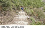 Купить «Couple walking along the stairs on the trek around Manaslu, village Prok, Nepal», видеоролик № 28660386, снято 17 июня 2018 г. (c) Dzmitry Astapkovich / Фотобанк Лори