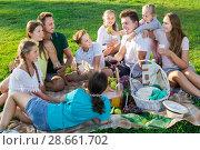 Купить «Group of nice people with kids enjoying picnic», фото № 28661702, снято 23 августа 2017 г. (c) Яков Филимонов / Фотобанк Лори