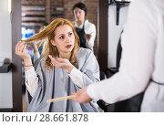 Купить «Dissatisfied adult woman is upset by her haircut», фото № 28661878, снято 7 марта 2017 г. (c) Яков Филимонов / Фотобанк Лори