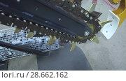 Купить «Trencher machine, a moving chain with many incisors», видеоролик № 28662162, снято 10 июня 2018 г. (c) Андрей Радченко / Фотобанк Лори