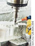Купить «Milling metalworking process. Industrial CNC metal machining by vertical mill», фото № 28664394, снято 17 мая 2017 г. (c) Дмитрий Калиновский / Фотобанк Лори