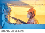 Купить «worker with demolition hammer breaking interior wall», фото № 28664398, снято 9 декабря 2017 г. (c) Дмитрий Калиновский / Фотобанк Лори