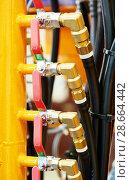 Купить «Hydraulic pressure pipes and connection fittings of industrial equipment», фото № 28664442, снято 25 мая 2015 г. (c) Дмитрий Калиновский / Фотобанк Лори
