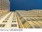 Купить «Modern building exterior», фото № 28664626, снято 9 июля 2018 г. (c) Ольга Сапегина / Фотобанк Лори