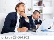Купить «two depressed men colleagues in office», фото № 28664902, снято 16 января 2019 г. (c) Яков Филимонов / Фотобанк Лори