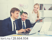 Купить «Two glad business male and woman in firm office», фото № 28664934, снято 31 мая 2020 г. (c) Яков Филимонов / Фотобанк Лори