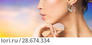 Купить «close up of beautiful woman face with earring», фото № 28674334, снято 9 апреля 2016 г. (c) Syda Productions / Фотобанк Лори