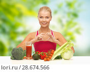 Купить «woman with vegetables and drink showing hand heart», фото № 28674566, снято 23 марта 2013 г. (c) Syda Productions / Фотобанк Лори